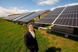 Michael Shore next to solar panels